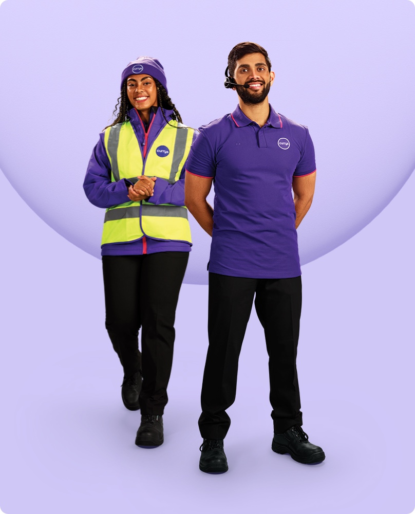 Currys expert wearing high vis jacket standing next to Currys expert with headset