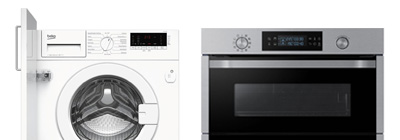 white washing machine with door and a grey cooker side by side.