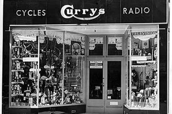 The front of a 1950s Currys store. Black and white.