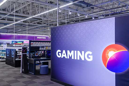 Big banner with 'gaming' and the currys logo on it in the gaming section of a Currys store.