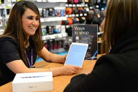 Currys expert discussing a tablet with a customer.