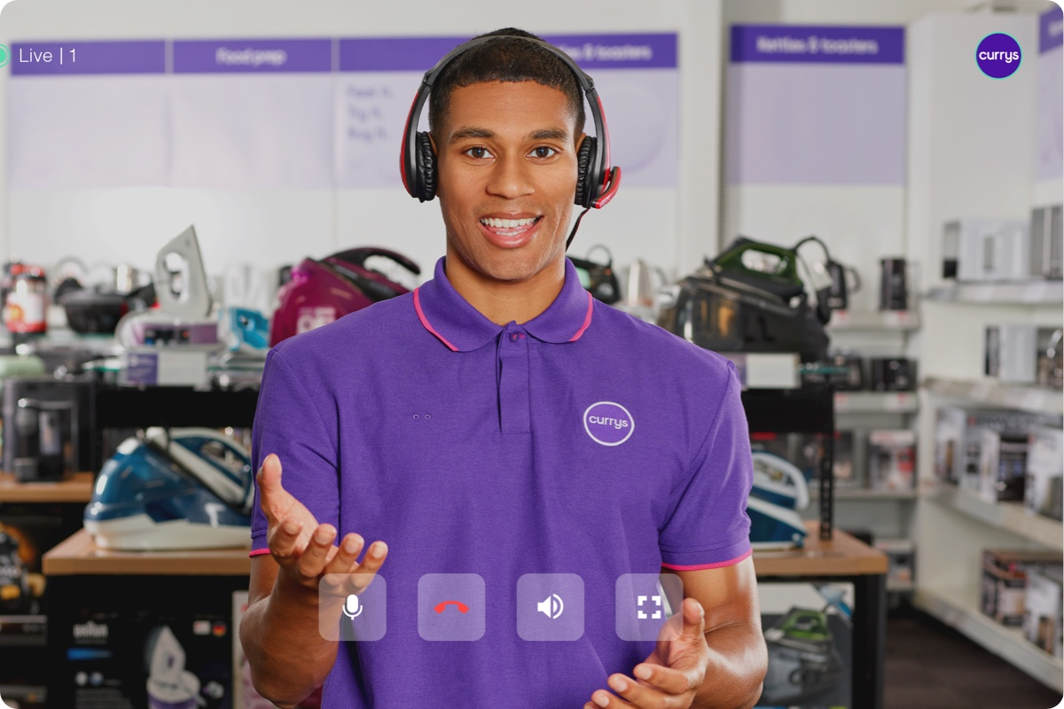 Currys expert with headset looking at camera with headset