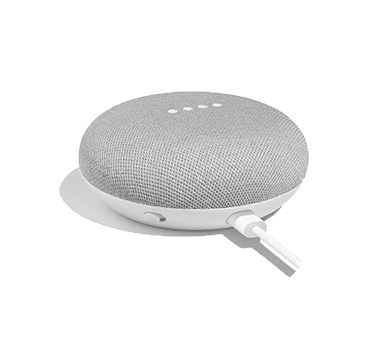 Google Home Mini. Photograph.