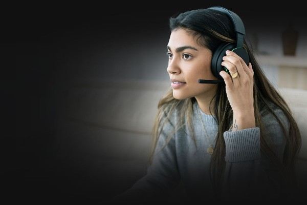 A woman speaking into an Xbox Wireless headset