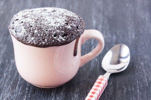 A chocolate mug cake in a pink mug
