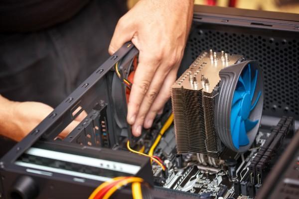 Someone installing a GPU into a PC case