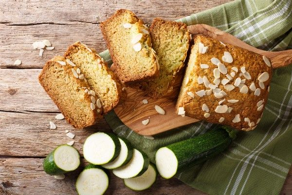 A chopping board with zucchini bread on it