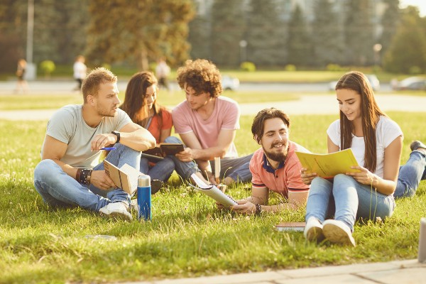A group of students hanging out in the park