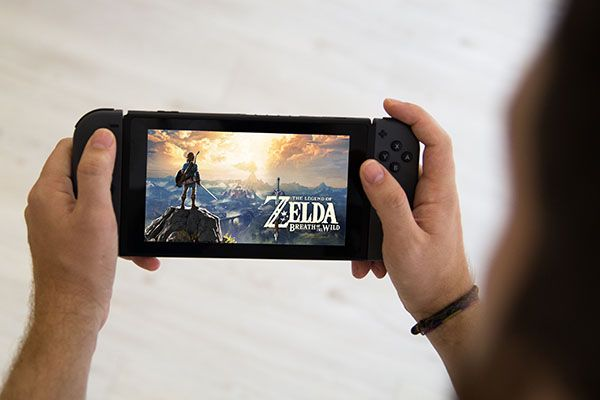 A person playing Legend of Zelda: Breath of the Wild on Nintendo Switch