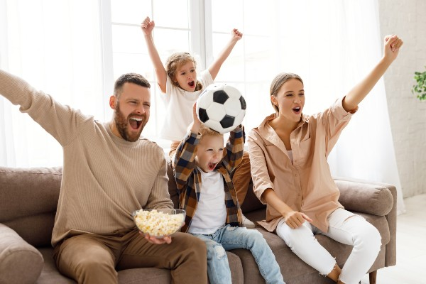 Family watching football on the TV