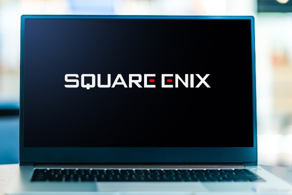 A laptop screen with the Square Enix logo on it