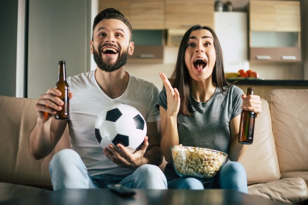 A couple watching football together