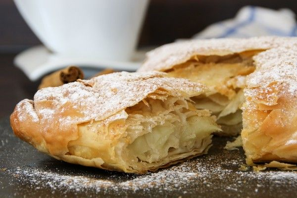 A danish made from puff pastry with icing sugar