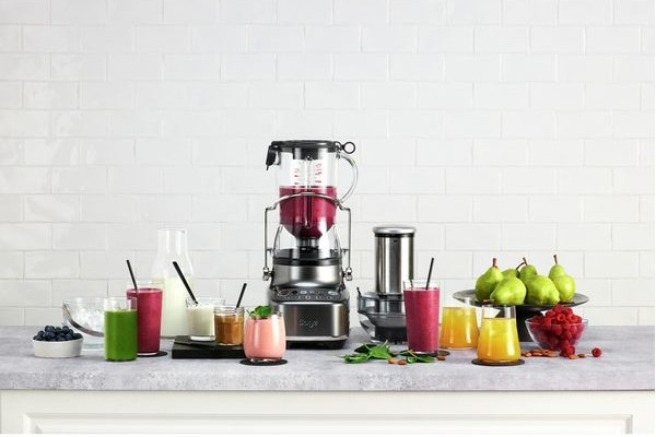 A Sage 3X Bluicer surrounded by fruit and different smoothies