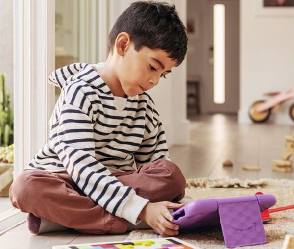 """Child playing with an Amazon Fire HD 8"""" Kids Tablet"""