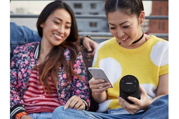 Two women with a Bose SoundLink Revolve II Portable Bluetooth Speaker