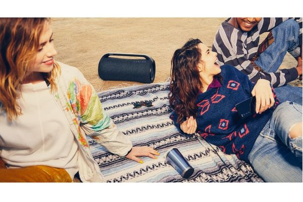 Two girls on the beach with the Sony SRS-XG500 portable bluetooth speaker